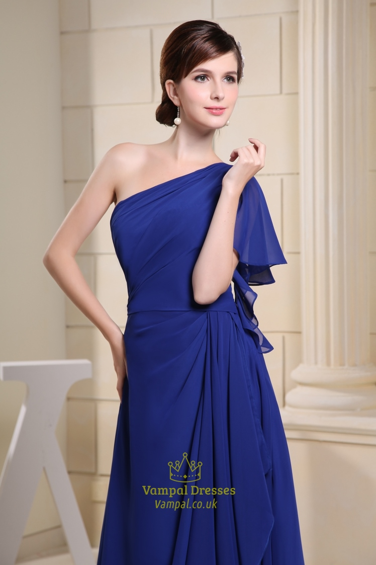 Plus size royal blue one shoulder mini dress with side cutouts, silver gem stone accents and a ruched back.