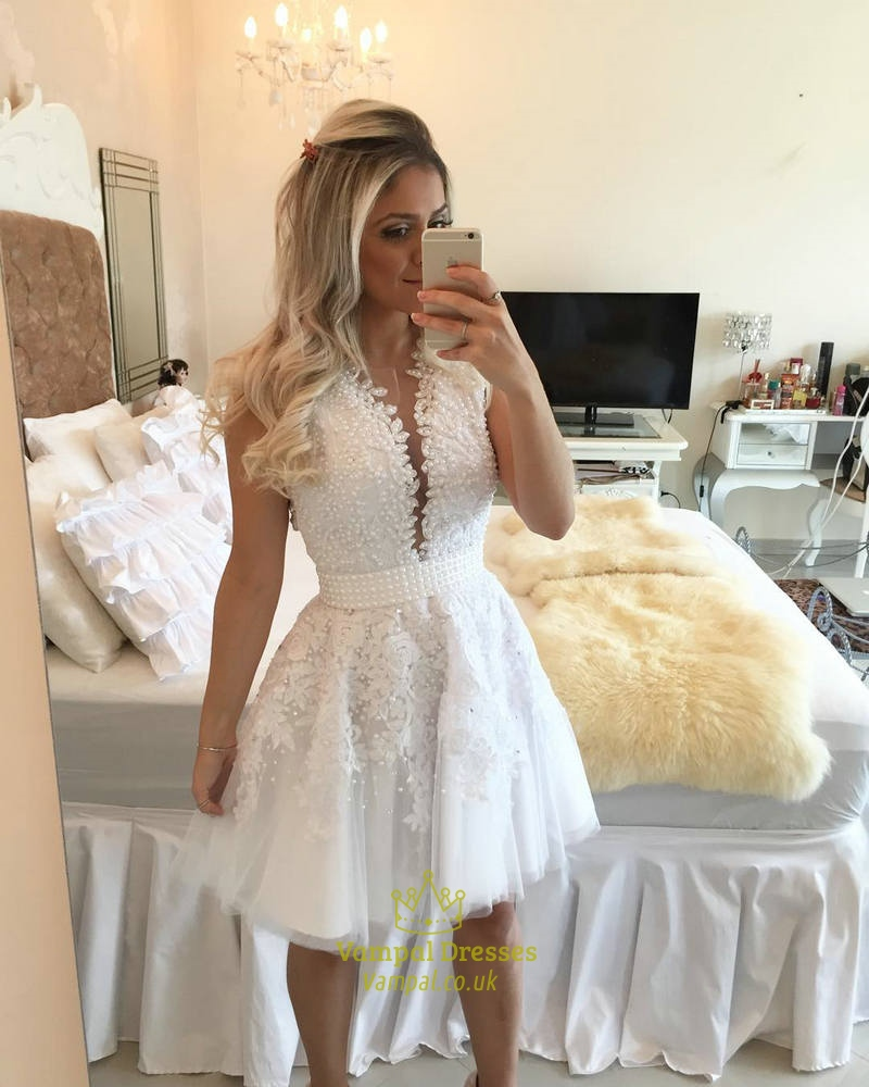 5ca59b1ca7f610 White Sleeveless Plunging V Neck Lace Applique Tulle Homecoming Dress