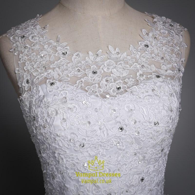 white sleeveless beaded floor length gown wedding