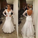 White Open Back Long Sleeve Lace Mermaid Wedding Dress With Bow