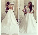 Ivory Sheer Long Sleeve Open Back Ball Gown Wedding Dress With Bow