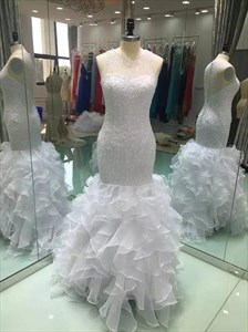 White Beaded Mermaid Style Wedding Dress With Ruffles At The Bottom