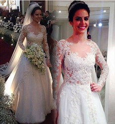 White Long Sleeve A Line Wedding Dress With Lace Overlay And Train