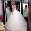 White Sleeveless Beaded Ball Gown Wedding Dress With Lace Overlay