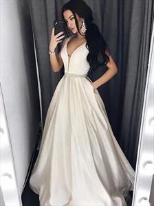 A Line Ivory V Neck Beaded Floor Length Satin Prom Dress With Pockets